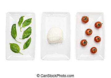 Italian food like flag, basil mozzarella tomato on white -...
