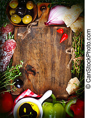 Italian food. Old cutting board surrounded by fresh food ...