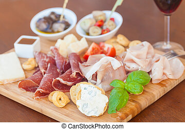 Italian food on chopping board - Tasty assortment of fresh ...
