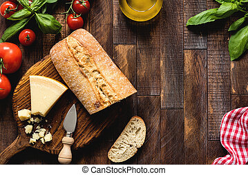 Italian food on rustic wood background, top view