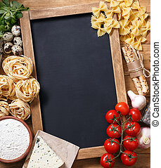 Italian food on vintage wood background with chalkboard