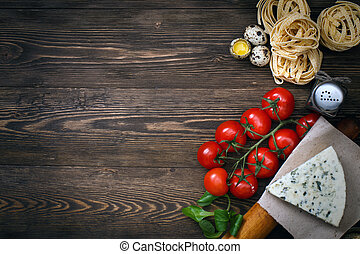 Italian food recipe on rustic wood - Overhead view of ...