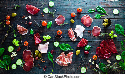 Italian ham, prosciutto and salami. Ingredients for ...