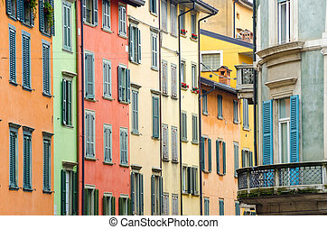 Italian houses with colorful walls and windows in Bergamo