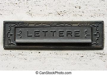 Italian iron mailbox - An iron vintage mailbox on gray wall,...