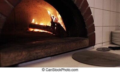 oven at pizzeria - italian kitchen and cooking concept -...