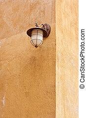 Italian lamp on orange wall