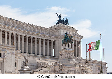 Italian national flag in front of Monumento nazionale a Vittorio