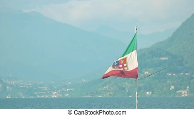 Italian naval ensign. Flag of Italy, landscape background.