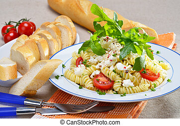 Pasta salad with ricotta cheese and rucola