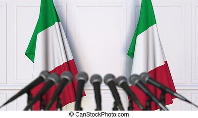 Italian official press conference. Flags of Italy and...