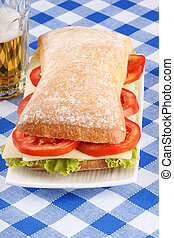 Italian panino sandwich and beer - Close-up of an italian...