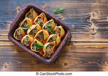 Italian pasta (conchiglioni)  stuffed with ground, mushrooms and parmesan cheese