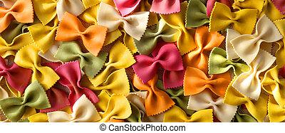 Italian pasta farfalle. Colourful green pasta background. Pasta recipes concept. Horizontal flat lay