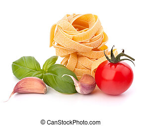 Italian pasta fettuccine nest and cherry tomato isolated on...
