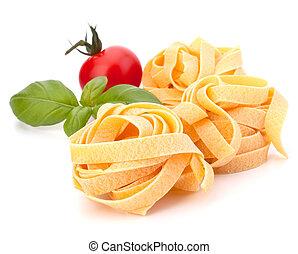 Italian pasta fettuccine nest and cherry tomato isolated on white background