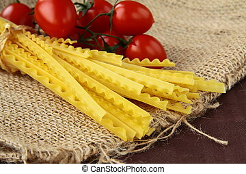 Italian pasta on a wooden board