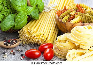 Italian pasta, spaghetti, fettuccine nest with garlic,...