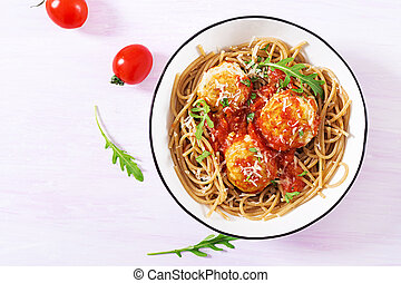 Italian pasta. Spaghetti with meatballs and parmesan cheese in bowl on light rustic wood background. Dinner. Top view. Slow food concept