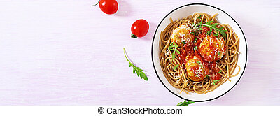 Italian pasta. Spaghetti with meatballs and parmesan cheese in bowl on light rustic wood background. Dinner. Top view. Banner. Slow food concept