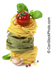 Italian pasta fettuccine nests with tomato and basil...
