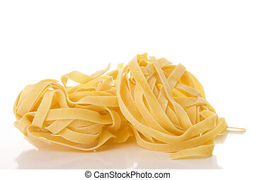 Tagliatelle - Italian pasta Tagliatelle isolated on white
