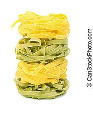 Italian pasta tagliatelle on a white background