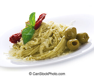 Italian Pasta With Pesto Sauce, Dried Tomato, Olives, Basil...