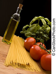 pasta - italian pasta with tomatoes basil and oil close up