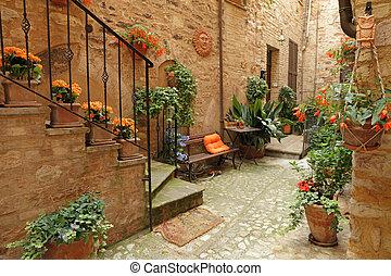 italian patio with flowers , Spello, Umbria