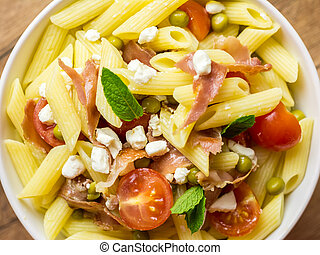 Italian Penne Pasta Salad With Mozzarella, Tomatoes And Prosciutto Ham