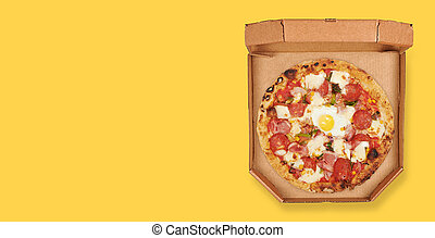 italian pizza in a box top view on yellow background
