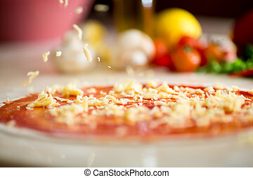 Italian pizza making with falling cheese
