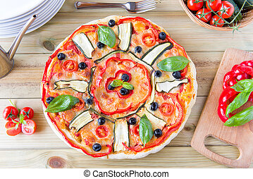 italian pizza with black olives, cherry tomatoes, eggplants and