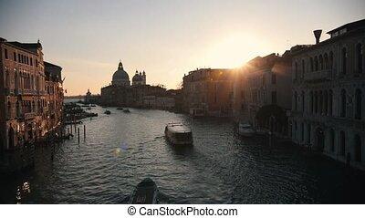 Italian port. Sunset. Boats sailing on the river. Beautiful...