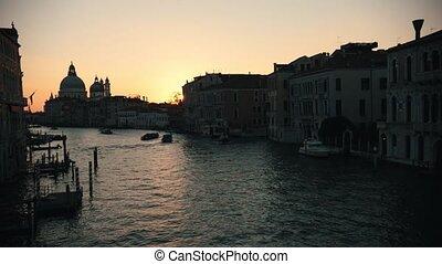 Italian port. Sunset. Cargo ships sailing. Beautiful...