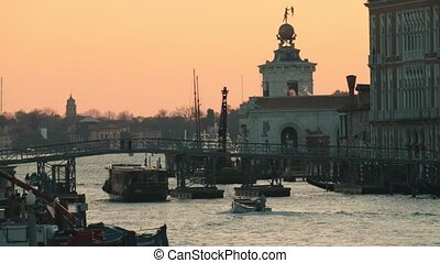 Italian port. Sunset. Cargo ships sailing Beautiful overview
