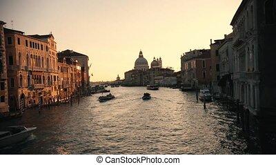 Italian port. Sunset. Tourist boats sailing on the river....