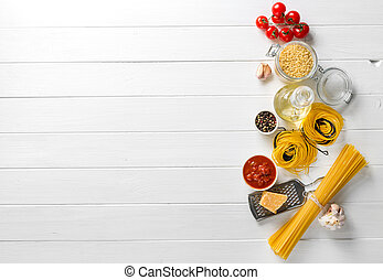 Italian raw pasta on wooden background