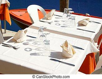 Italian restaurant on the Canal in Venice - set the table an...