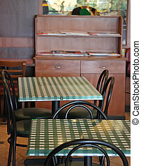 Italian restaurant with chairs and tables with checked...