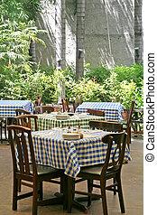 Italian restaurant - Outdoor italian restaurant with chairs...