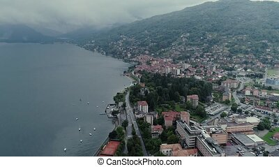 Italian riviera houses drone flight near the mountains,...
