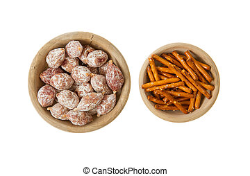 Italian salami and typical dutch salty snacks in wooden bowl