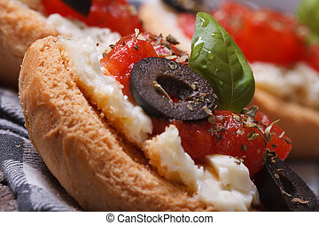 Italian sandwich with tomatoes, feta cheese and olives