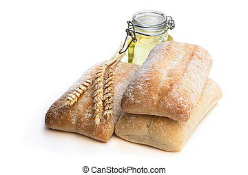 Italian slyle bread ciabatta with olive oil isolated on white