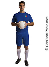 Italian soccer player holding ball on white background