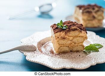 Italian tiramisu dessert on a porcelain plate
