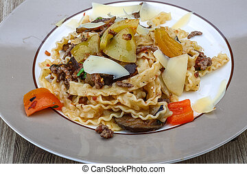 Italian trditional Pasta mafalde with herbs and beef meat