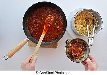 Italian woman cooking homemade Spaghetti Bolognese - POV of ...